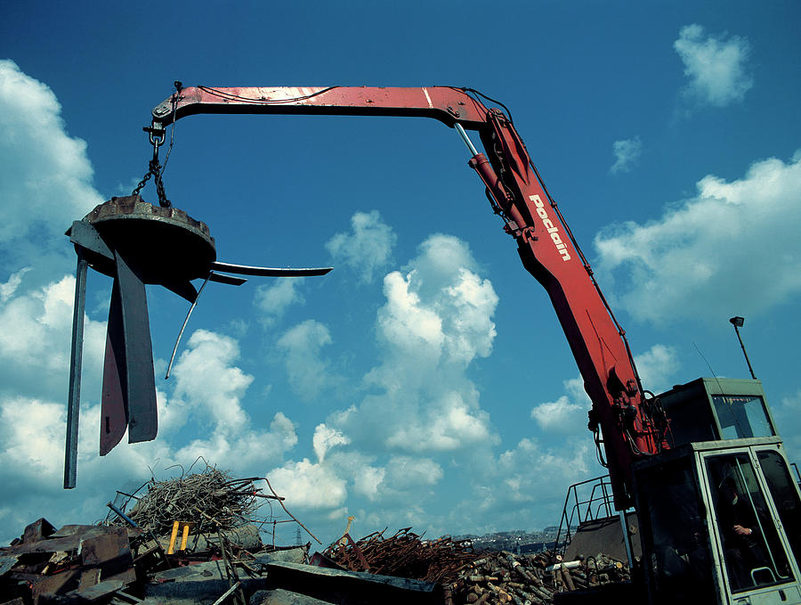 Magnet Photograph - Large Electromagnet In Use At A Scrapyard by Simon Fraser/science Photo Library