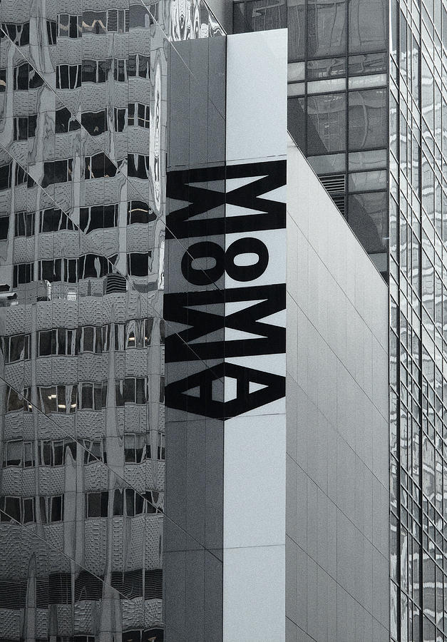 large moma banner on mirrored exterior wall of the museum. Black Bedroom Furniture Sets. Home Design Ideas