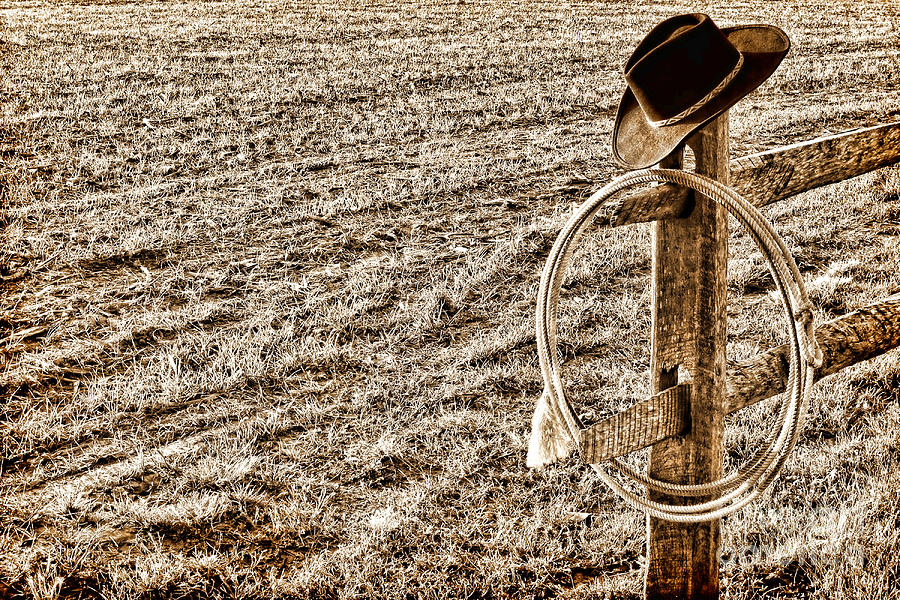 West Photograph - Lasso And Hat On Fence Post by Olivier Le Queinec