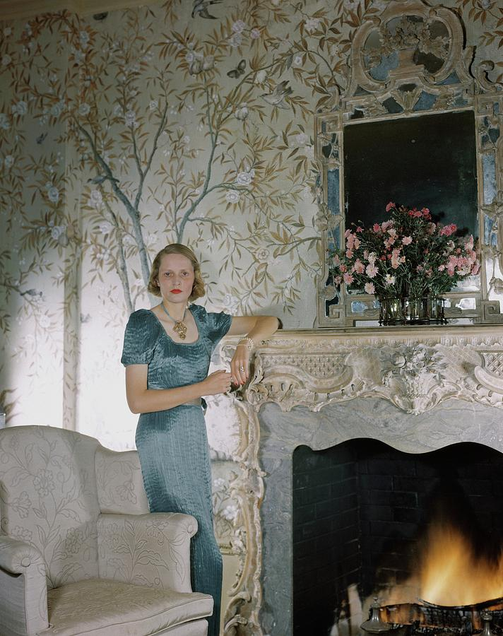 Laura Elizabeth Curtis By A Fireplace Photograph by Horst P. Horst