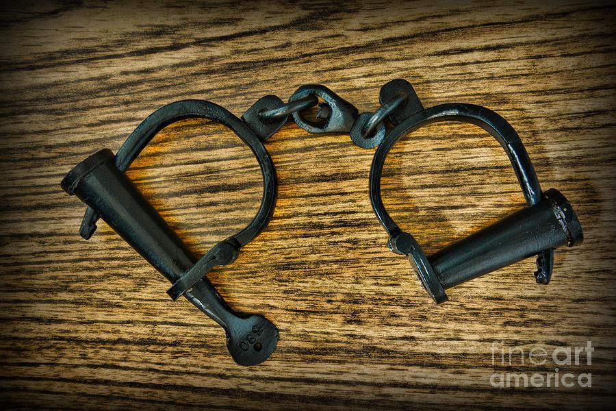 Paul Ward Photograph - Law Enforcement - Antique Handcuffs by Paul Ward