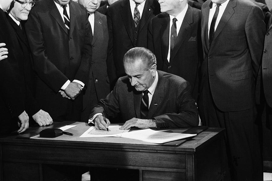 1960's Photograph - Lbj Signs Civil Rights Bill by Underwood Archives Warren Leffler