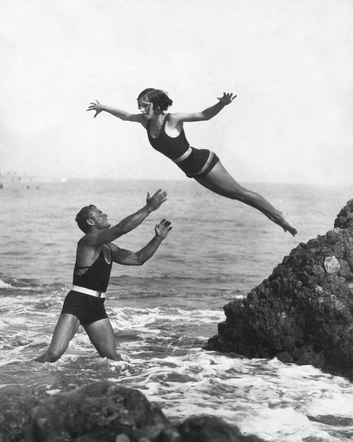1920s Photograph - Leap Into Life Guards Arms by Underwood Archives