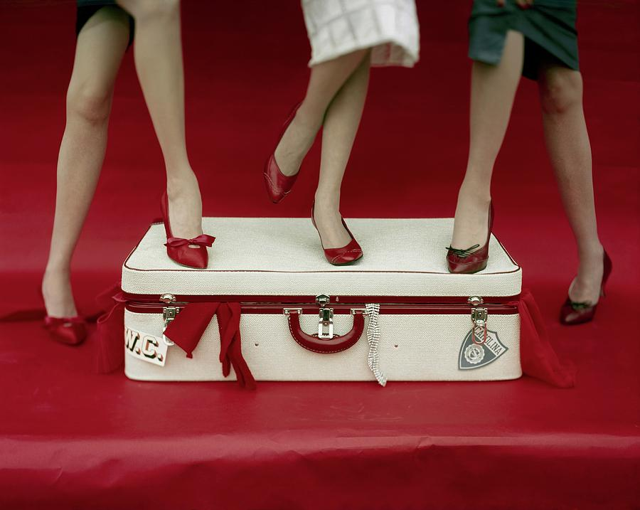 Legs Of Models Standing On A Suitcase Photograph by Sante Forlano