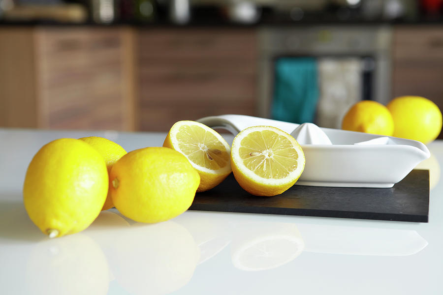 Lemons And Juicer On Kitchen Counter Photograph by Debby Lewis-harrison
