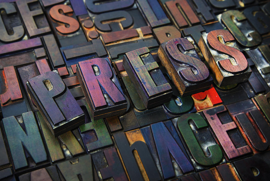 Letterpress letters spelling the word Press Photograph by Guido Cavallini