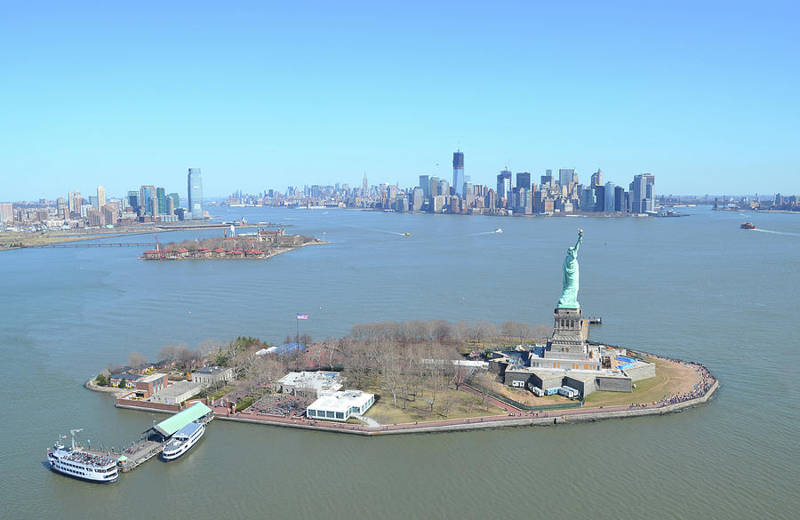 Liberty And Ellis Island With Manhattan Photograph by Mrtom-uk