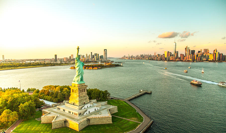 Liberty Island Overlooking Manhattan Skyline Photograph by GCShutter