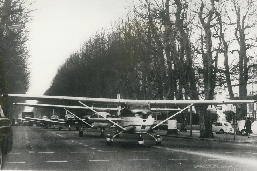 Retro Photograph - Light Aircraft In March Past by Retro Images Archive
