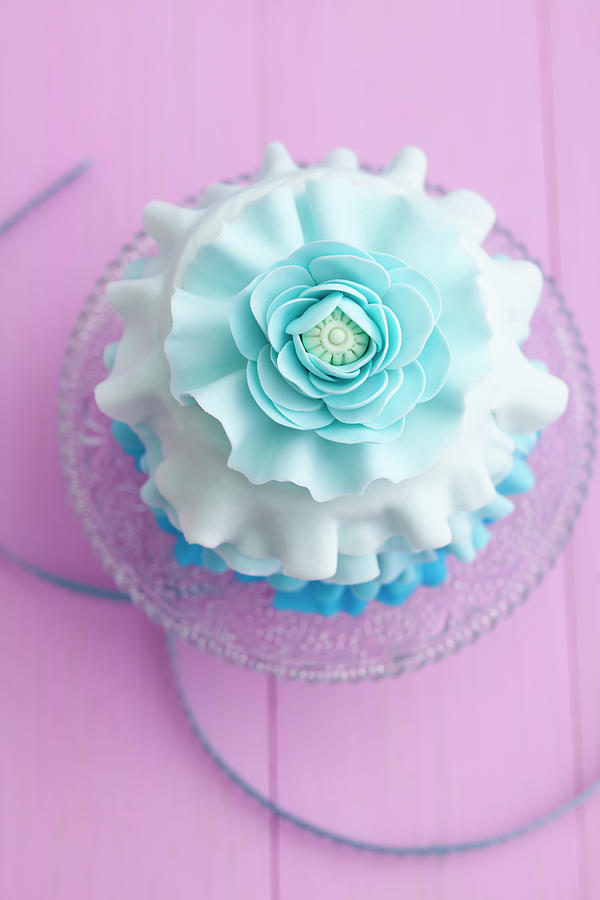 Light Blue Mini Cake On Cakestand Photograph by Westend61