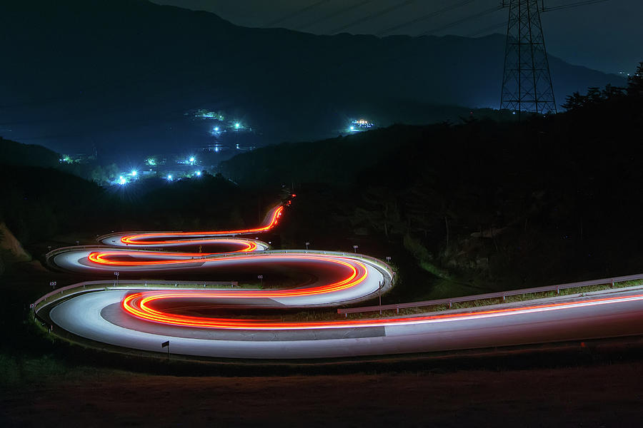 Light Trails Of Cars On The Zigzag Way Photograph by Tokism