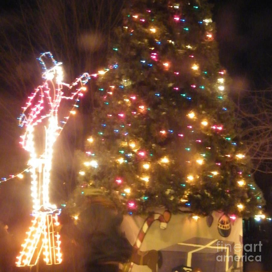 Lighted decorating of tree by Ronda Douglas