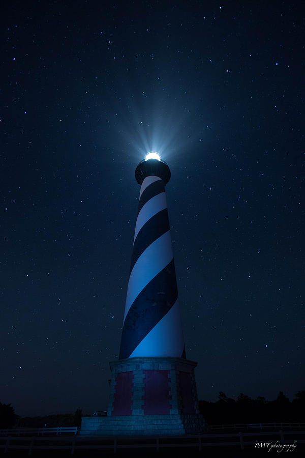 Lighthouse In Stars Photograph by Paul Treseler
