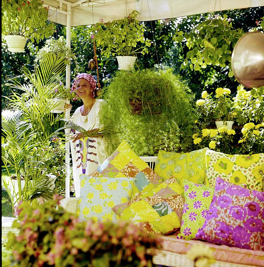 Lilly Pulitzer In Her Garden Photograph by Horst P. Horst