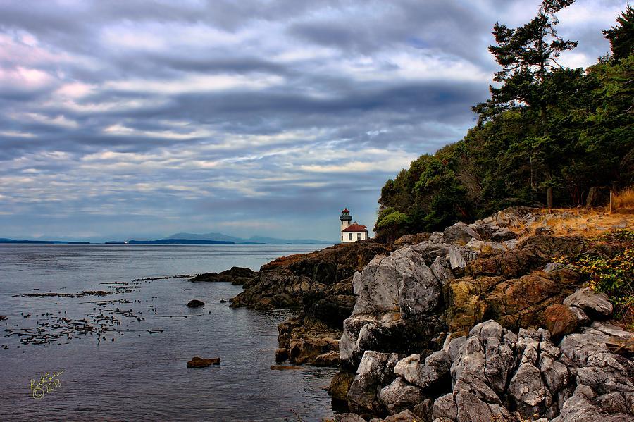 Lime Kiln Lighthouse And Rocks Photograph
