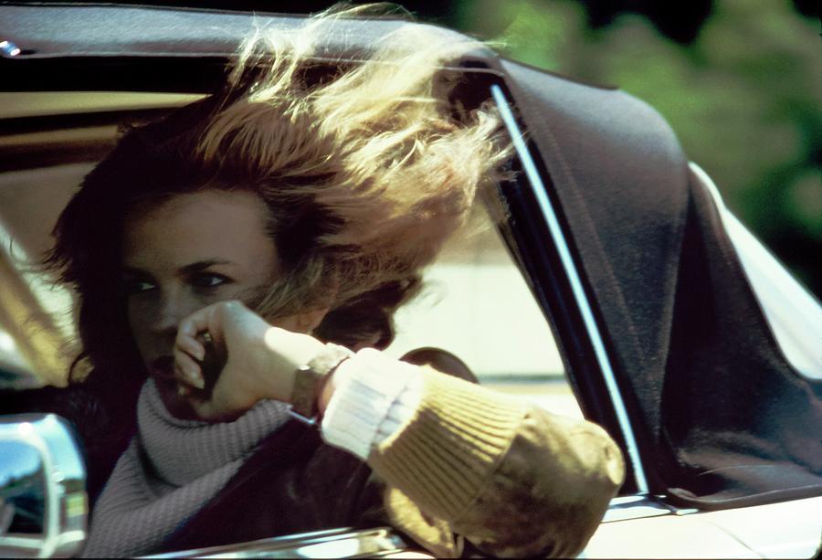 Lisa Taylor Driving A Car Photograph by Arthur Elgort