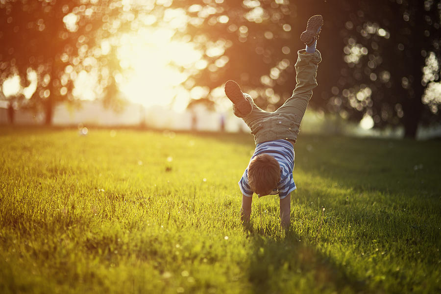 Little boy standing on hands on grass Photograph by Imgorthand