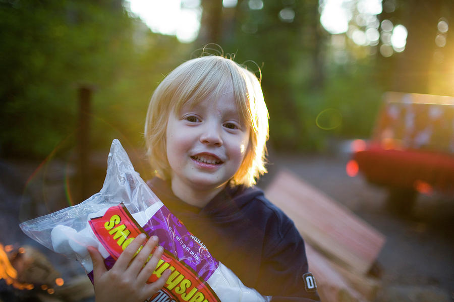 Blond Photograph - Little Boy With A Large Bag by Jan Sonnenmair