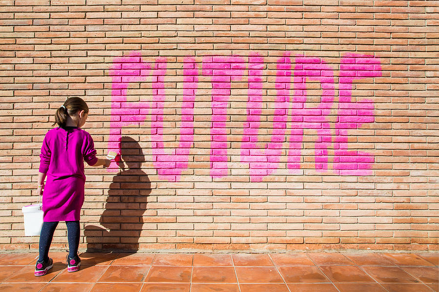 Little Girl Painting With Pink Colors The Future Word In A Brick Wall, A Protest Action Claiming For Future To The New Generations. Photograph by Artur Debat