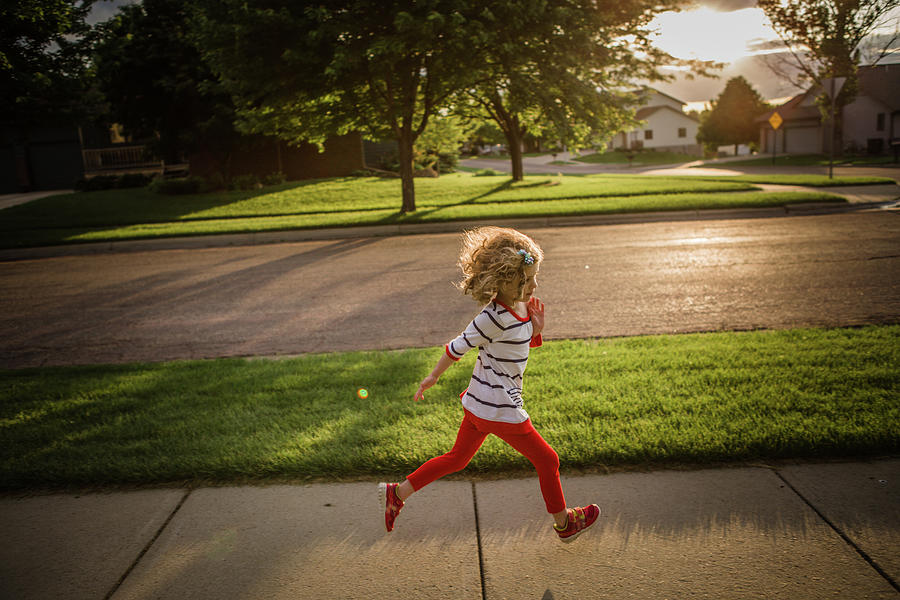 Little Girl Running Photograph by Annie Otzen