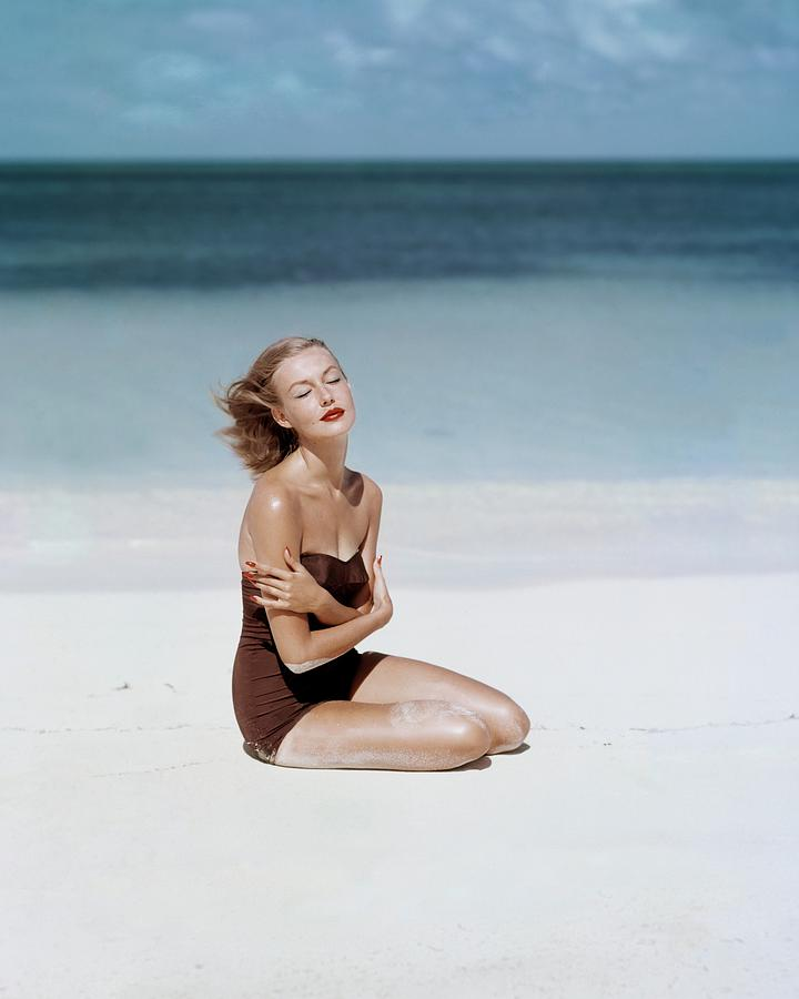 Liz Benn Sitting On A Beach Photograph by John Rawlings