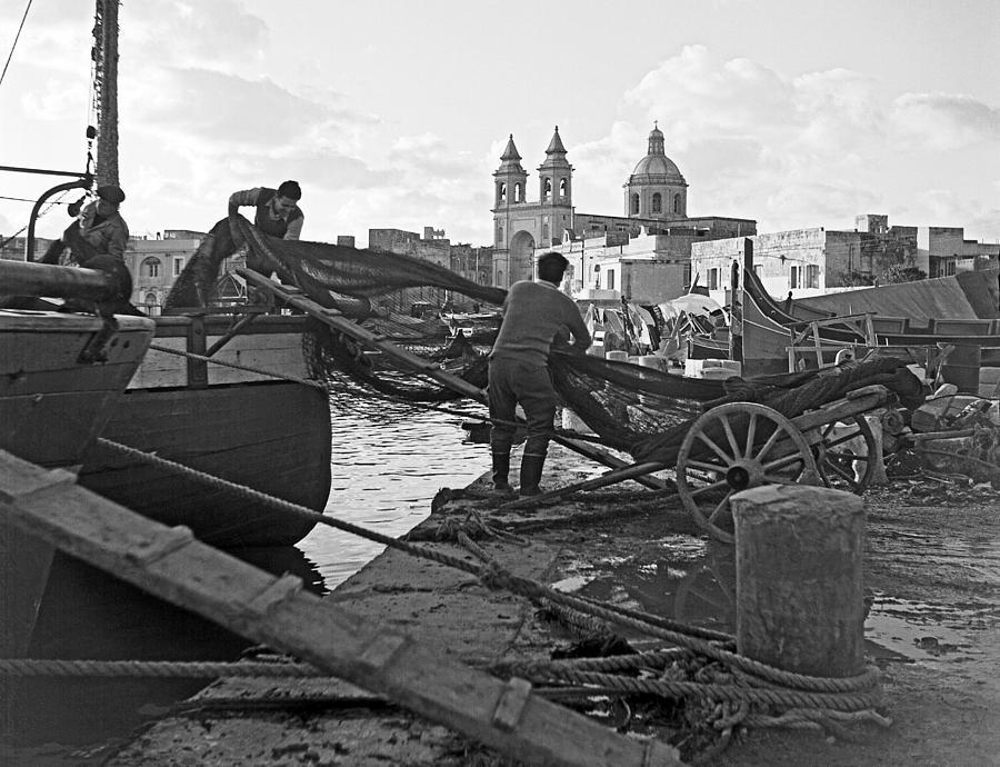 Marsaxlokk Photograph - Loading Nets In Malta by David Murphy