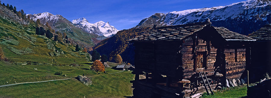 Color Image Photograph - Log Cabins On A Landscape, Matterhorn by Panoramic Images