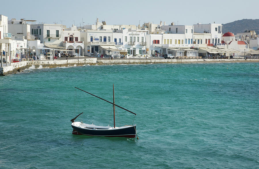 Lone Boat Anchored Off Mykonos - A Photograph by Gregory Adams