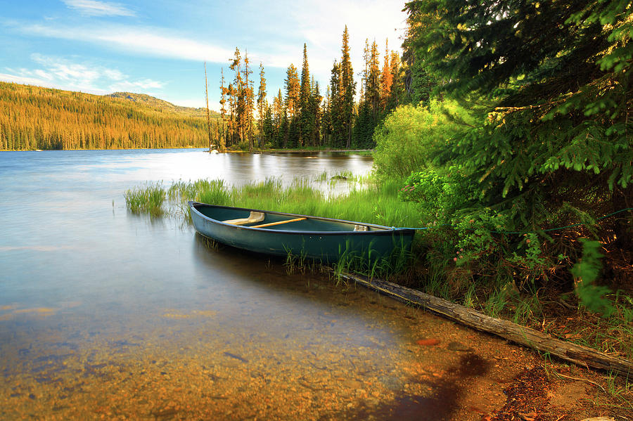 Lone Canoe On Shores Of Upper Payette Photograph by Anna Gorin