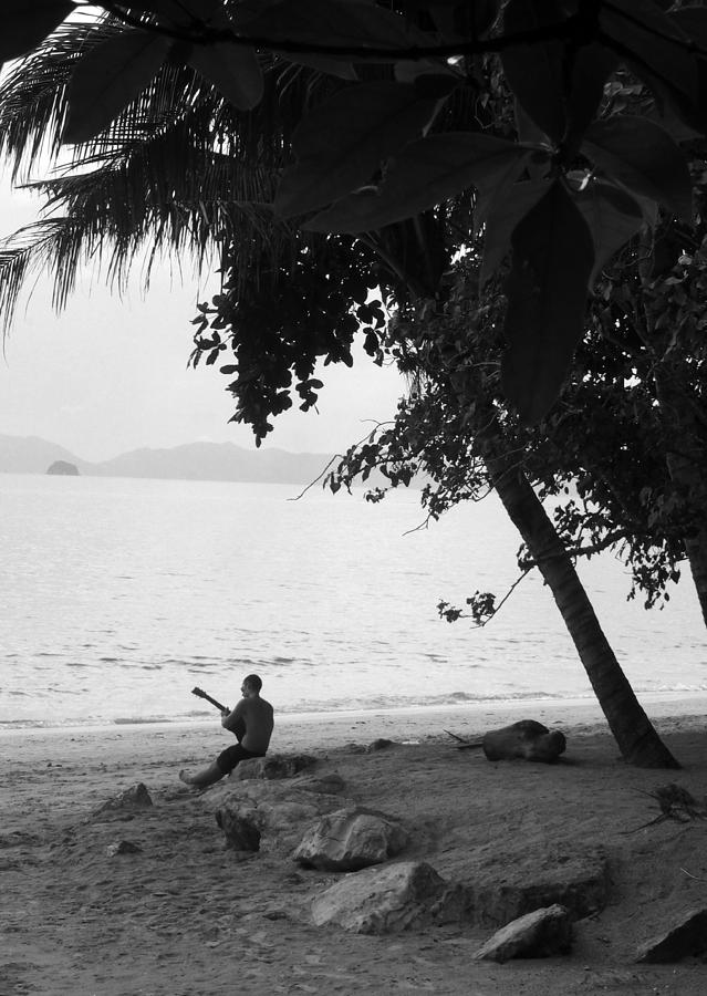 Lonely Guitarist Photograph