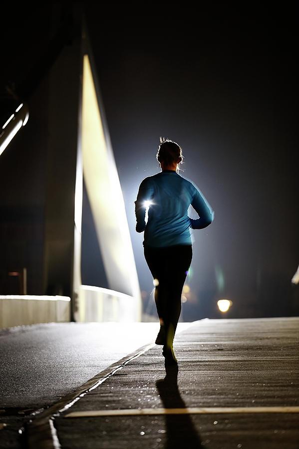 Lonely Runner On Bridge Photograph by Henrik Sorensen