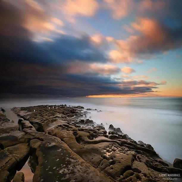 Long Exposure Sunset Of An Incoming Photograph by Larry Marshall