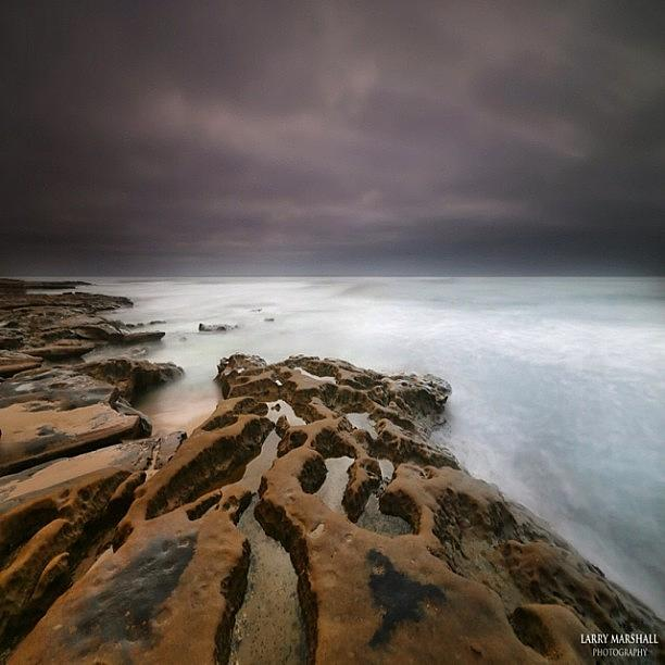 Long Exposure Sunset On A Dark Stormy Photograph by Larry Marshall