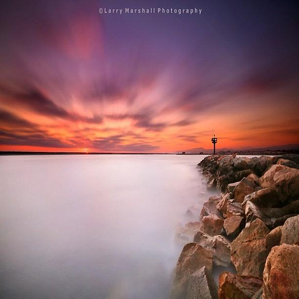 Long Exposure Sunset Shot At A Rock Photograph by Larry Marshall