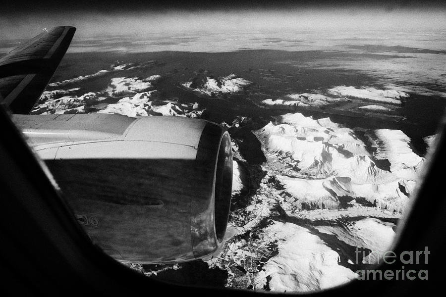 Looking Photograph - Looking Out Of Aircraft Window Over Engine And Snow Covered Fjords And Coastline Of Norway Europe by Joe Fox