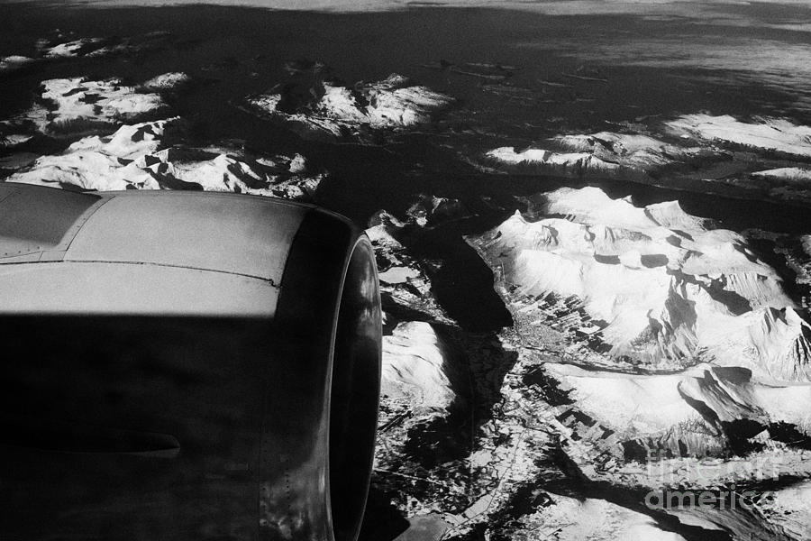 Looking Photograph - Looking Out Of Aircraft Window Past Engine And Over Snow Covered Fjords And Coastline Of Norway Euro by Joe Fox
