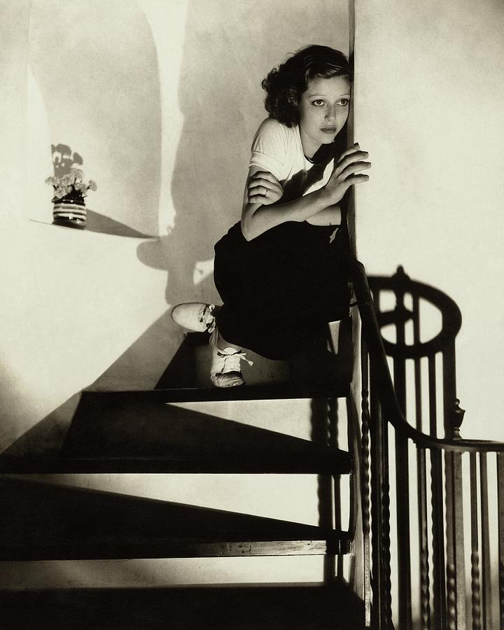 Loretta Young Sitting On A Staircase Photograph by Edward Steichen