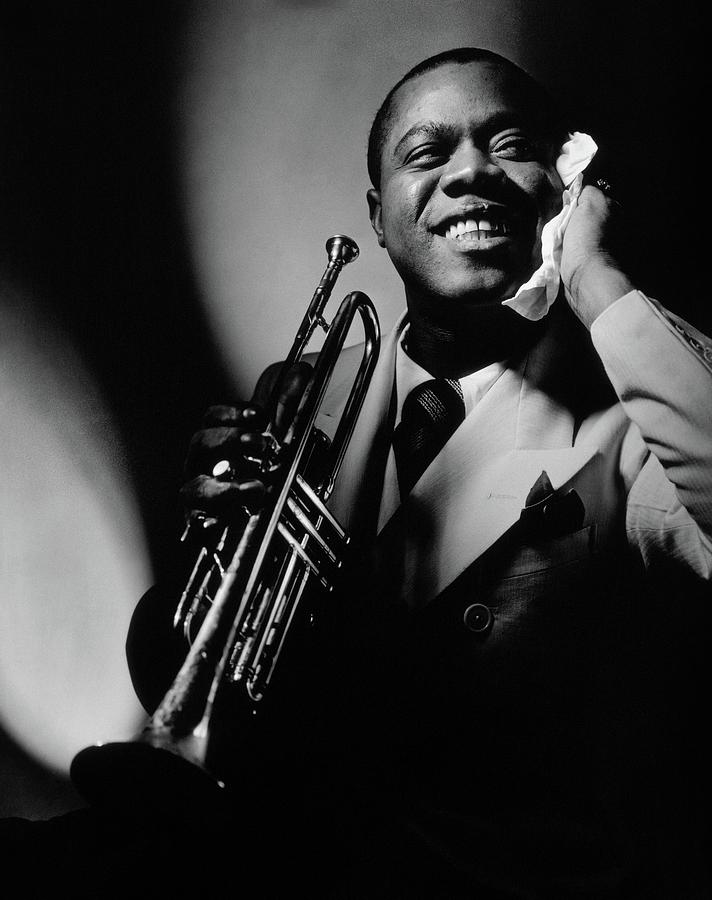 Louis Armstrong Holding A Trumpet Photograph by Anton Bruehl