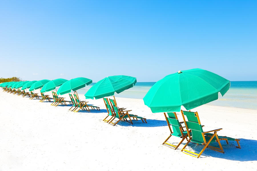 Lounge Chairs and Umbrella at the Beach Photograph by Bertlmann