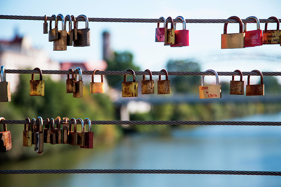 Love Locks Hang From Kettenbrücke Photograph by Holger Leue