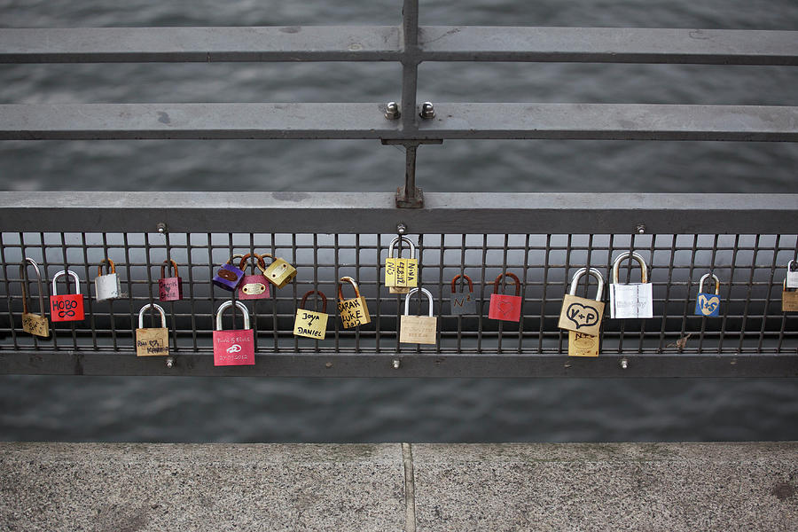 Love Padlocks Hanging In A Row On A Photograph by Halfdark