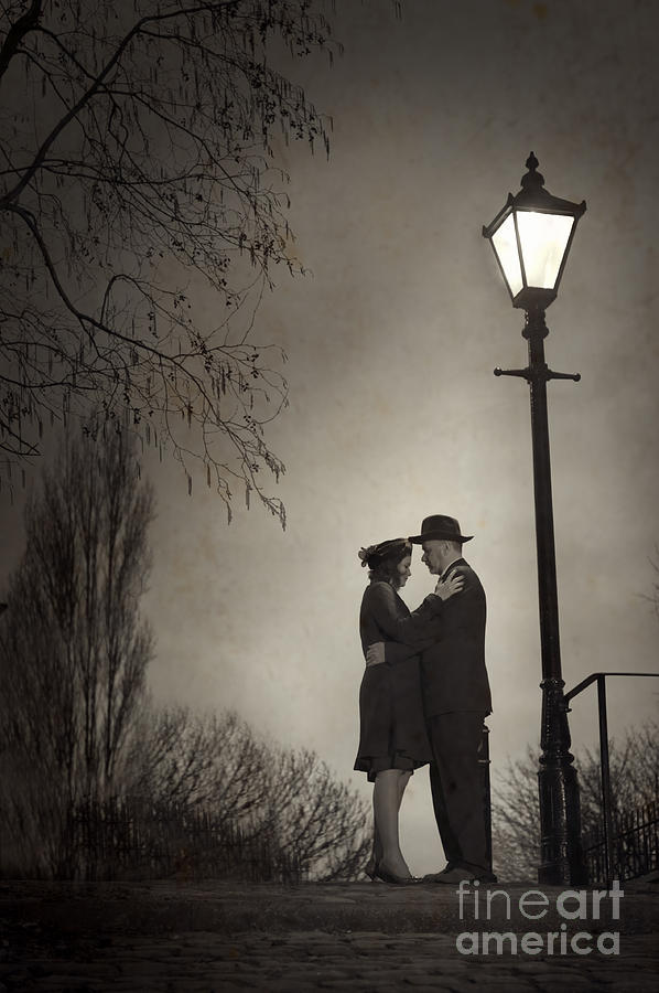 Lovers Embracing Under A Street Light Photograph By Lee Avison