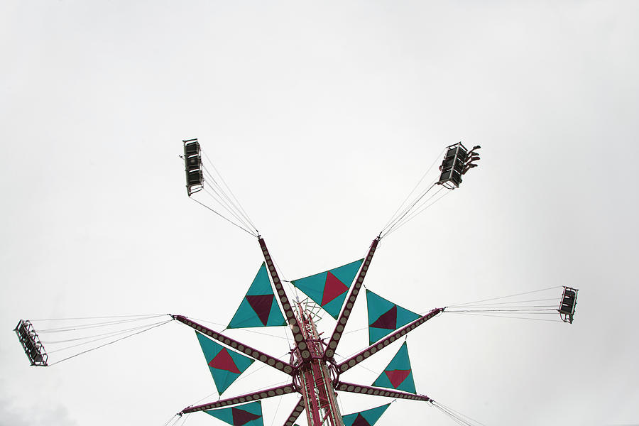 Low Angle View Of A Fairground Swing Photograph by Frederick Bass