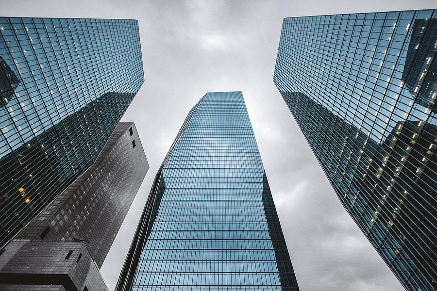 Low Angle View Of Modern Buildings Photograph by Oliver Byunggyu Woo / Eyeem