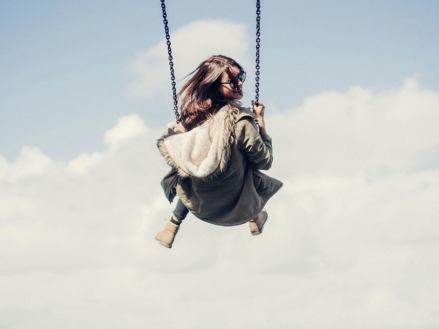 Low Angle View Of Woman On Swing Photograph by Denise Kwong / Eyeem