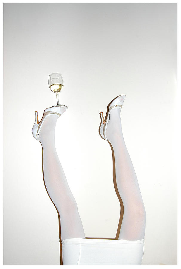Low Section Of Woman Balancing Wine Photograph by Kostis Fokas / Eyeem