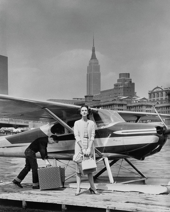 Lucille Cahart With Small Plane in NYC Photograph by John Rawlings