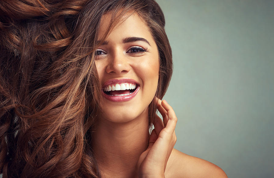 Lucious locks and happy laughter Photograph by PeopleImages