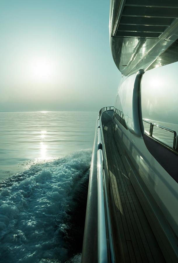 Luxury Motor Yacht Sailing At Sunset Photograph by Petreplesea