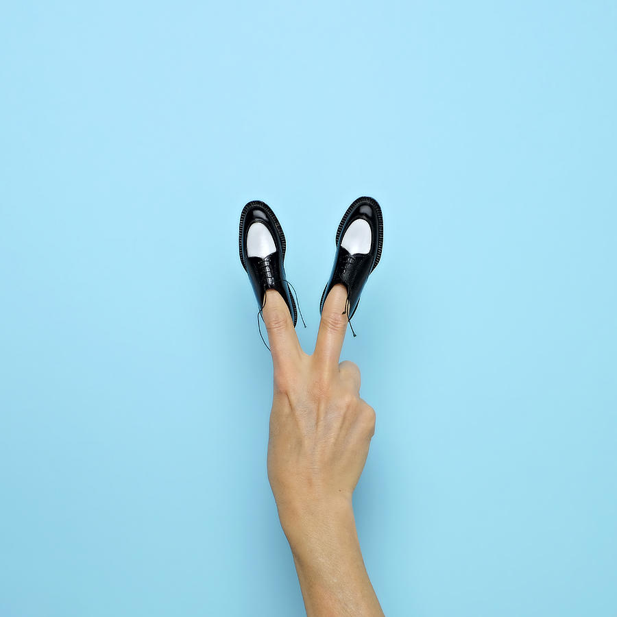 Making Peace Sign With Miniature Shoes Photograph by Juj Winn